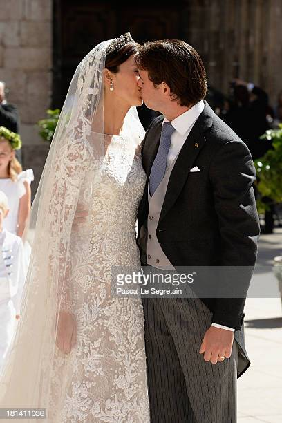 Princess Claire Of Luxembourg and Prince Felix Of Luxembourg kiss as they depart their wedding ceremony at the Basilique Sainte MarieMadeleine on...