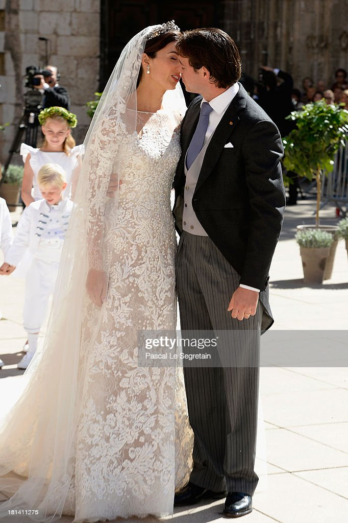 Princess Claire Of Luxembourg and Prince Felix Of Luxembourg kiss as they depart their wedding ceremony at the Basilique Sainte Marie-Madeleine on September 21, 2013 in Saint-Maximin-La-Sainte-Baume, France.