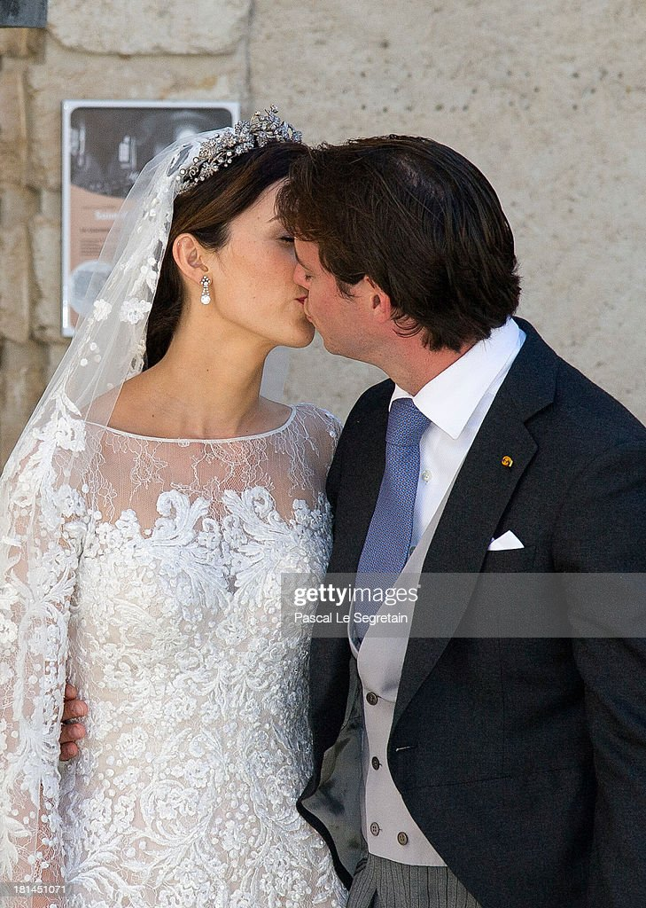 Princess Claire Of Luxembourg and Prince Felix Of Luxembourg kiss as they depart from their wedding ceremony at the Basilique Sainte Marie-Madeleine on September 21, 2013 in Saint-Maximin-La-Sainte-Baume, France.