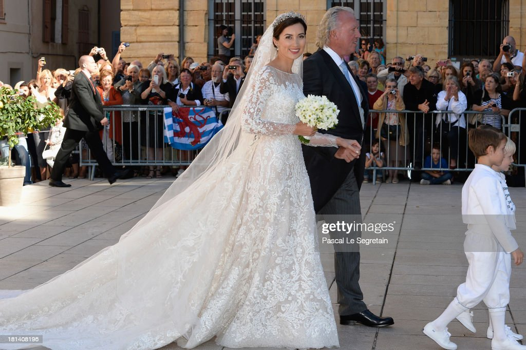 Princess Claire Of Luxembourg, her father Hartmut Lademacher, Prince Gabriel Of Luxembourg and Prince Noah Of Luxembourg arrive to the Religious Wedding Of Prince Felix Of Luxembourg and Claire Lademacher at the Basilique Sainte Marie-Madeleine on September 21, 2013 in Saint-Maximin-La-Sainte-Baume, France.