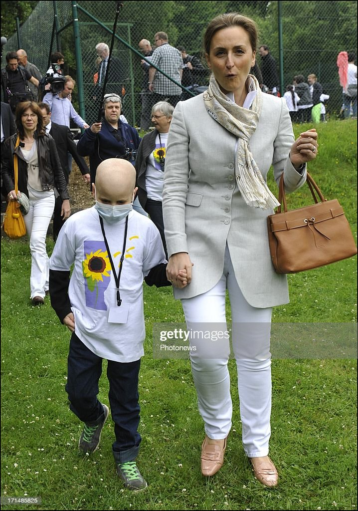 Princess Claire visits a sick child at Camp Tournesol on June 25, 2013 in Spa, Belgium. Camp Tournesol was created to help kids suffering from cancer.