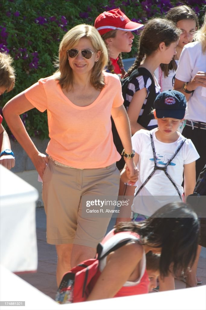 Princess Cristina of Spain and her daugther Irene Urdangarin arrive at Calanova Sailing School on July 29, 2013 in Palma de Mallorca, Spain.