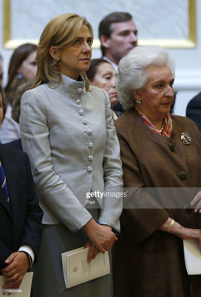 <a gi-track='captionPersonalityLinkClicked' href=/galleries/search?phrase=Princess+Cristina+of+Spain&family=editorial&specificpeople=160232 ng-click='$event.stopPropagation()'>Princess Cristina of Spain</a> and the King's sister Dona Pilar are seen at the Mass commemorating the centenary of the birth of Don Juan de Borbon in the chapel of the Royal Palace in Madrid, Spain on June 20, 2013. The mass was attended by the Prince of Asturias, Spain's Prime Minister Mariano Rajoy, and other senior government officials.