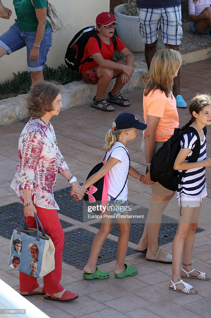 Princess Cristina of Spain (2R), her daughter Irene Urdangarin (3R), her niece Victoria Federica de Marichalar (R) and her mother Queen Sofia of Spain (L) are seen in Mallorca on July 29, 2013 in Mallorca, Spain. Princess Cristina of Spain comes back to Mallorca after two years.