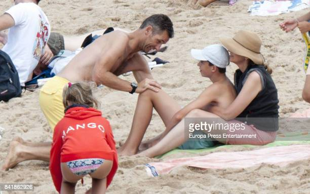Princess Cristina of Spain Inaki Urdangarin and their son Pablo Urdangarin are seen on August 6 2017 in Bidart France