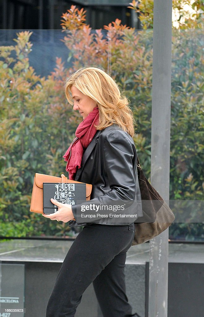 <a gi-track='captionPersonalityLinkClicked' href=/galleries/search?phrase=Princess+Cristina+of+Spain&family=editorial&specificpeople=160232 ng-click='$event.stopPropagation()'>Princess Cristina of Spain</a> walks to her office at La Caixa Foundation on April 8, 2013 in Barcelona, Spain. A Spanish court has named <a gi-track='captionPersonalityLinkClicked' href=/galleries/search?phrase=Princess+Cristina+of+Spain&family=editorial&specificpeople=160232 ng-click='$event.stopPropagation()'>Princess Cristina of Spain</a> a suspect and she will have to explain her role as a board member of a non-profit foundation set up by her husband Inaki Urdangarin. The son-in-law of King Juan Carlos of Spain, Inaki Urdangarin, Duke of Palma is currently on trial over allegations that he misused millions of euros of public funds, allocated to organise sports and tourism events, during his time a chairman of the 'Instituto Noos' non-profit foundation from 2004 to 2006.