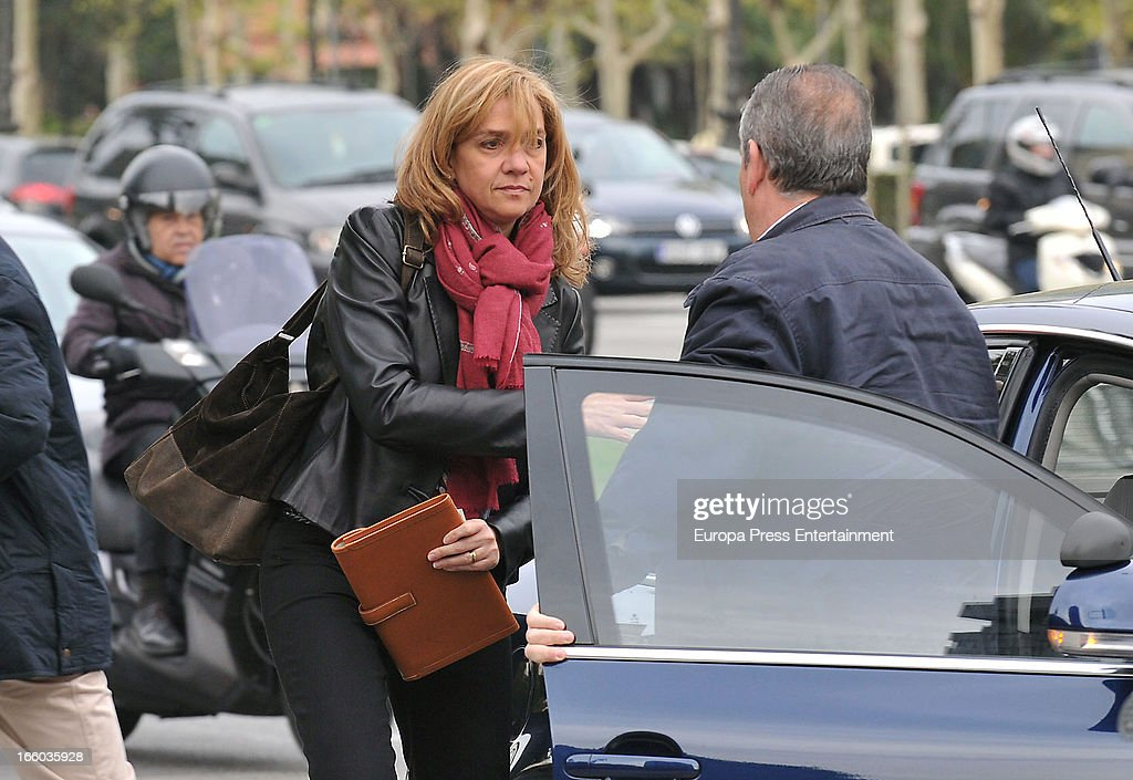 Princess Cristina of Spain walks to her office at La Caixa Foundation on April 8, 2013 in Barcelona, Spain. A Spanish court has named Princess Cristina of Spain a suspect and she will have to explain her role as a board member of a non-profit foundation set up by her husband Inaki Urdangarin. The son-in-law of King Juan Carlos of Spain, Inaki Urdangarin, Duke of Palma is currently on trial over allegations that he misused millions of euros of public funds, allocated to organise sports and tourism events, during his time a chairman of the 'Instituto Noos' non-profit foundation from 2004 to 2006.