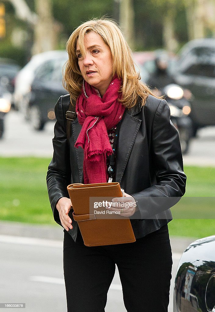 Princess Cristina of Spain walks to her office on April 8, 2013 in Barcelona, Spain. A Spanish court has named Princess Cristina of Spain a suspect and she will have to explain her role as a board member of a non-profit foundation set up by her husband Inaki Urdangarin. The son-in-law of King Juan Carlos of Spain, Inaki Urdangarin, Duke of Palma is currently on trial over allegations that he misused millions of euros of public funds, allocated to organise sports and tourism events, during his time a chairman of the 'Instituto Noos' non-profit foundation from 2004 to 2006.