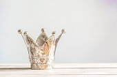Princess crown with hearts on a wooden table