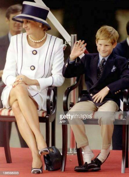 Princess Diana and her son Harry watch veterans as they march past a dais on the Mall as part of the commemorations of VJ Day 19 August The...
