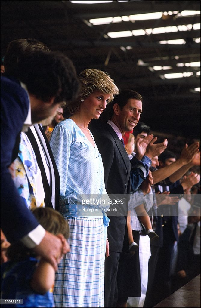Princess Diana and HRH Prince Charles stand in the crowd during the Live Aid concert at Wembley Stadium on 13 July, 1985 in London, England. Live Aid was watched by millions around the world on television and raised vast quantities of donated money to help relieve a severe famine in Ethiopia.