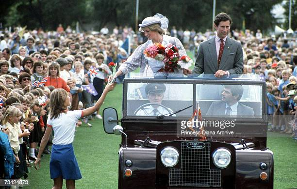 Princess Diana and Prince Charles riding in a Land Rover at the Hands Oval sportsground Bunbury Australia 8th April 1983