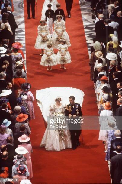 Princess Diana And Prince Charles Walking Down The Aisle Of St Paul's In London On Their Wedding Day With Their Bridesmaids And Pageboys