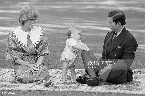 Princess Diana and Prince Charles watch as their infant son William takes his first steps in public during a royal visit to New Zealand