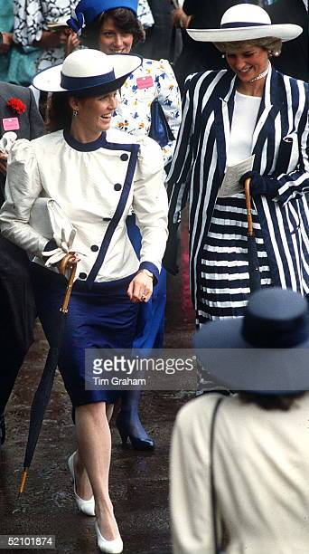 Princess Diana And Sarah Duchess Of York Walking Together At Royal Ascot They Are Both Carrying Umbrellas The Princess Is Wearing A Blue And White...
