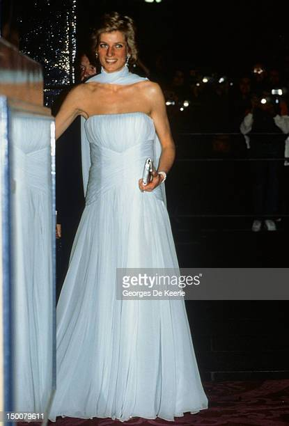 Princess Diana arrives at the Theatre Royal Drury Lane London for a performance of the musical 'Miss Saigon' She is wearing a pale blue chiffon...