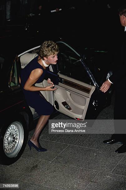 Princess Diana arrives wearing a navy shift dress at a film premiere London 23rd September 1993