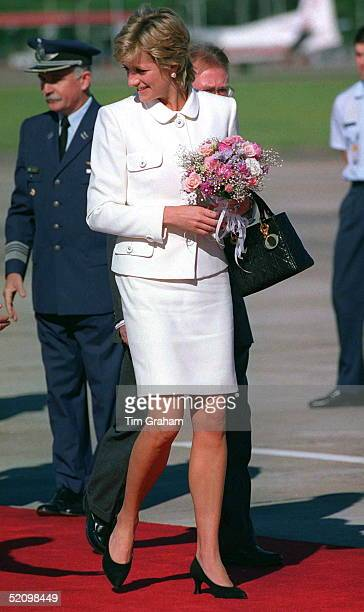 Princess Diana Arriving At Buenos Aires Airport For Her Historic Visit To Argentina The Princess Is Wearing A White Suit Designed By Fashion Designer...