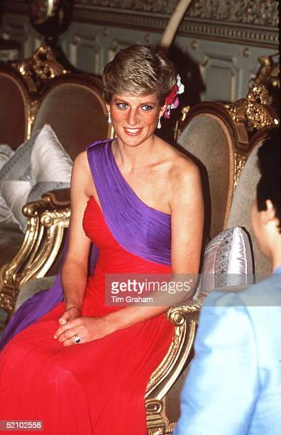 Princess Diana At A Dinner In Bangkok Thailand In Febuary 1988 Wearing A Red And Purple Chiffon Evening Dress Designed By Fashion Designer Catherine...