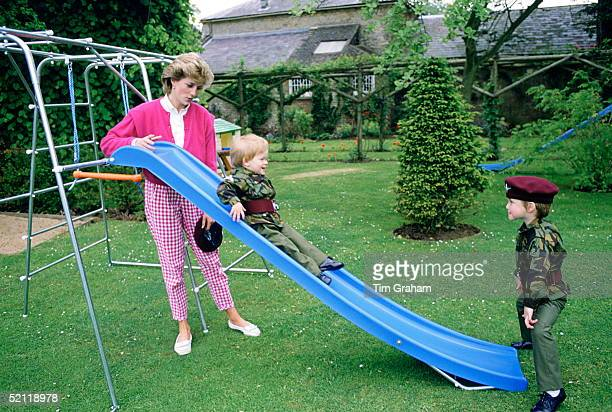 Princess Diana At Highgrove With Prince William And Prince Harry Dressed In Miniature Parachute Regiment Uniforms And Playing On Their Slide In The...