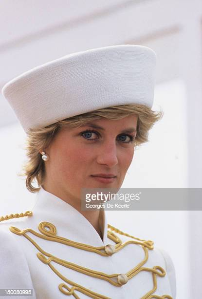 Princess Diana attends a passing out parade at Sandhurst on April 10 she is wearing a military style suit by Catherine Walker and hat by Graham Smith...