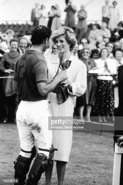 Princess Diana awarding her husband Prince Charles a trophy during a polo match at Windsor to raise funds for the Birthright charity 29th June 1985