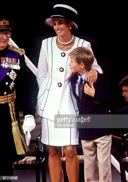 Princess Diana Cuddles Prince Harry During The Vj Day Celebrations