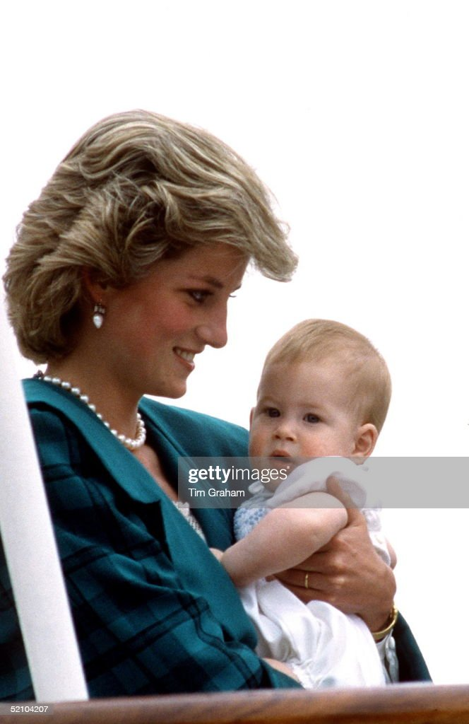 Princess Diana Cuddling Her Baby Son, Prince Harry, Aboard The Royal Yacht Britannia During Her Royal Tour Of Italy.