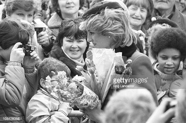 Princess Diana greets the crowd during a walkabout in Leicestershire on March 22 1984