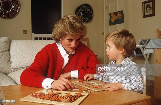 Princess Diana Helping Prince William With A Jigsaw Puzzle In His Playroom At Home In Kensington Palace