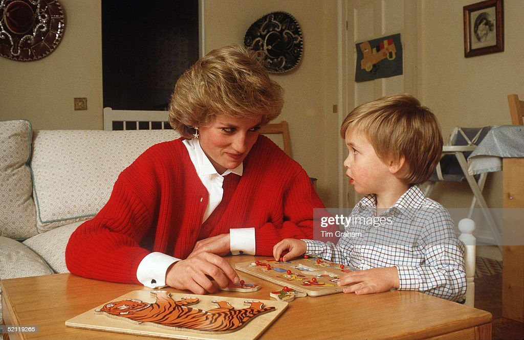 Princess Diana Helping Prince William With A Jigsaw Puzzle Toy In His Playroom At Home In Kensington Palace