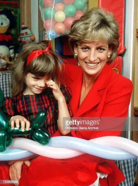 Princess Diana holding the child of an HIV patient at the London Lighthouse a centre for people affected by HIV and AIDS in London October 1996