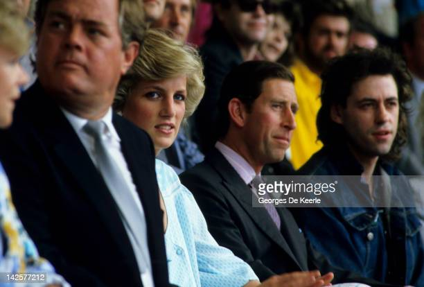 HRH Princess Diana HRH Prince Charles and Bob Geldof watch from the crowd during the Live Aid concert at Wembley Stadium in London 13th July 1985 The...