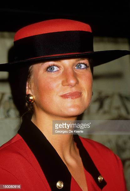 Princess Diana in a red outfit on a visit to Caen September 1987