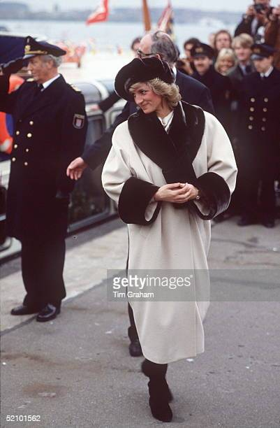 Princess Diana In Hamburg Wearing A Coat Designed By Arabella Pollen With A Fake Fur Trim On Collar And Cuffs And A Fake Fur Beret Style Hat
