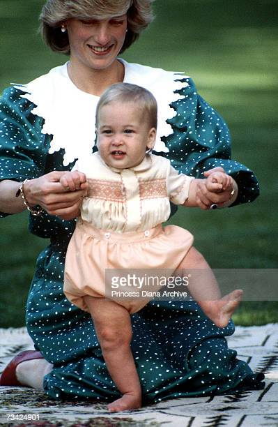 Princess Diana in the grounds of Government House in Auckland New Zealand with her son Prince William 23rd April 1983 The princess is wearing a dress...