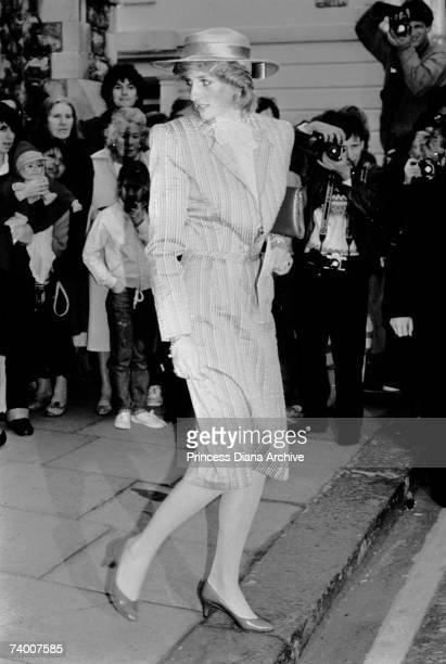 Princess Diana is photographed by paparazzi attending the wedding of her friend Anne Bolton 28th October 1983