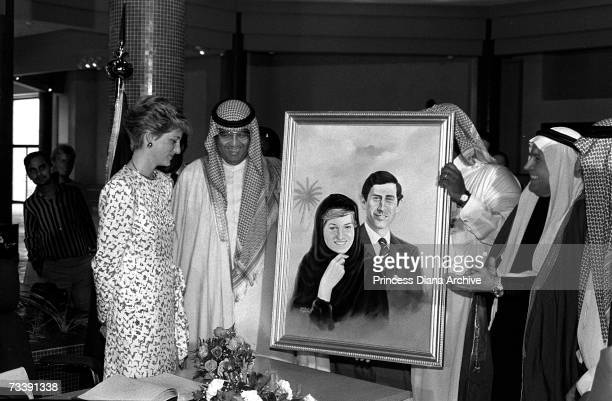 Princess Diana is presented with a painting during a visit a centre for handicapped people in Riyadh Saudi Arabia November 1986 Her outfit is...