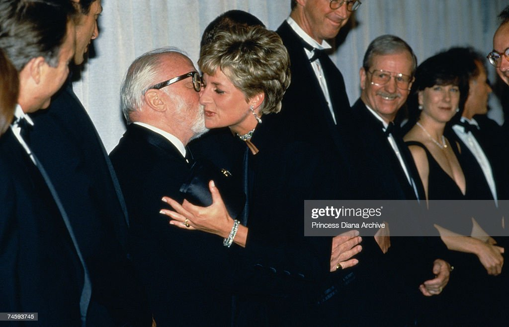 Princess Diana (1961 - 1997) kisses British actor and director Richard Attenborough at the London premiere of Steven Spielberg's film 'Jurassic Park', 15th July 1993.