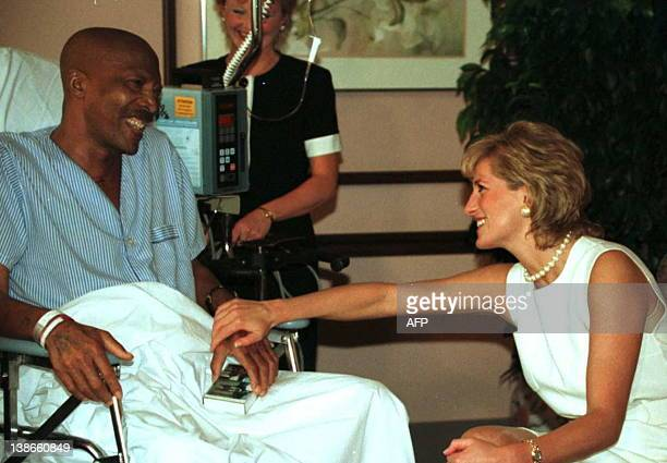 Princess Diana meets with John Collins a 51yearold lung cancer patient while touring Northwestern Memorial Hospital's Hospice Palliative Care Unit in...