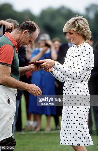 Princess Diana Presenting A Prize To Prince Charles' Polo Manager Ronald Ferguson At Polo Windsor Her Dress Is By Fashion Designer Victor Edelstein...