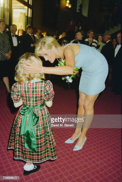 Princess Diana receives a bouquet from a young girl at the Royal Albert Hall after an English National Ballet production of 'Swan Lake' London 3rd...