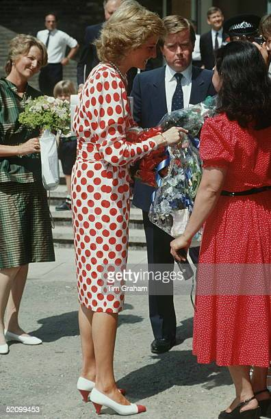 Princess Diana Receiving A Bouquet Of Flowers During Her Visit To The Royal College Of Artaccompanied By Her Bodyguard Ken Wharfe And Lady In Waiting...