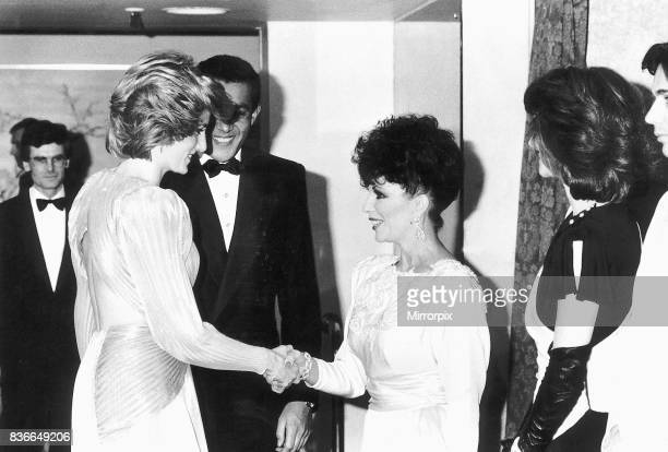 Princess Diana shakes hands with actress Joan Collins at a Bruce Oldfield London fashion soiree held at Grosvenor House in London in aid of the...