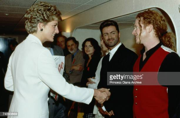 Princess Diana shakes hands with singer Mick Hucknall of Simply Red at a rock concert for World AIDS Day at Wembley London 2nd December 1993 British...