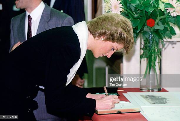 Princess Diana Signing The Visitor's Book During A Visit To Marks Spencers Shopping Store In Paris