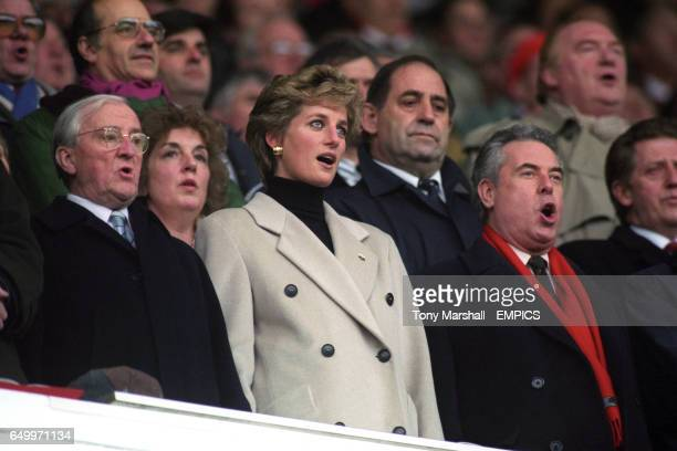 Princess Diana singing during the National Anthems before the match