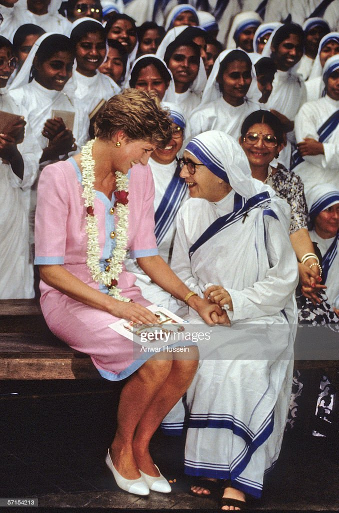 Princess Diana the Princess of Wales holds hands with a nun at Mother Teresa's Hospice in Calcutta during her visit to India in February of 1992.