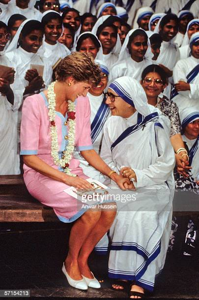 Princess Diana the Princess of Wales holds hands with a nun at Mother Teresa's Hospice in Calcutta during her visit to India in February of 1992