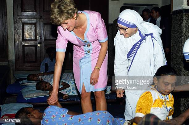 Princess Diana the Princess of Wales offers comfort to a patient at Mother Teresa's Hospice in Calcutta on February 15 1992 in Calcutta India